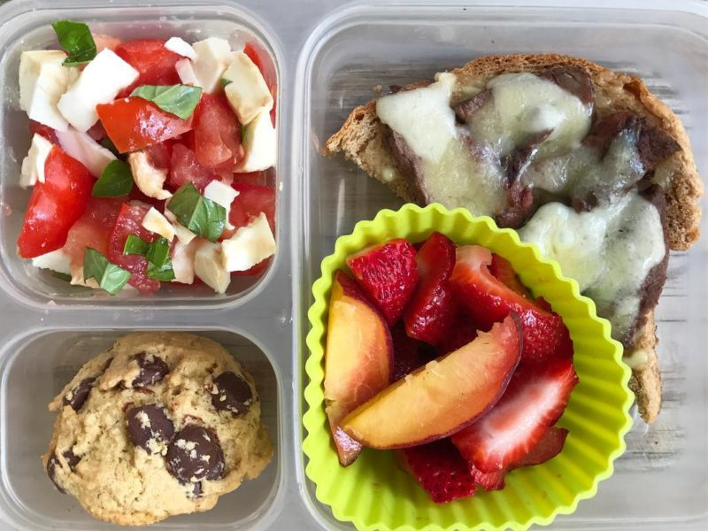 Leftover sliced steak and melted cheese on open-faced sandwich, Caprese salad, Peaches and strawberries, Homemade whole wheat chocolate chip cookie - School Lunch Roundup 12 on 100 Days of Real Food