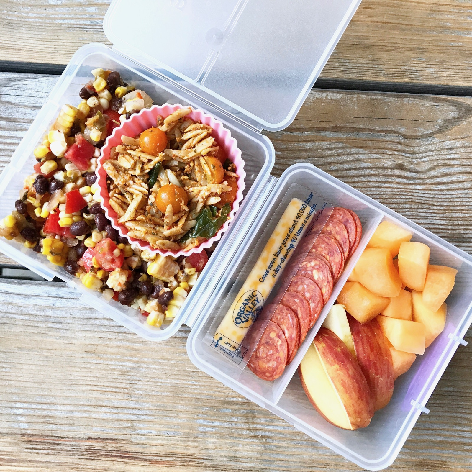 Packed school lunch of A thrown together corn/tomato/black bean salad (made with leftover corn on the cob) Pasta Salad with Red Pepper Pesto (coming to the blog soon) Cheese stick Organic pepperoni Apples and cantaloupe