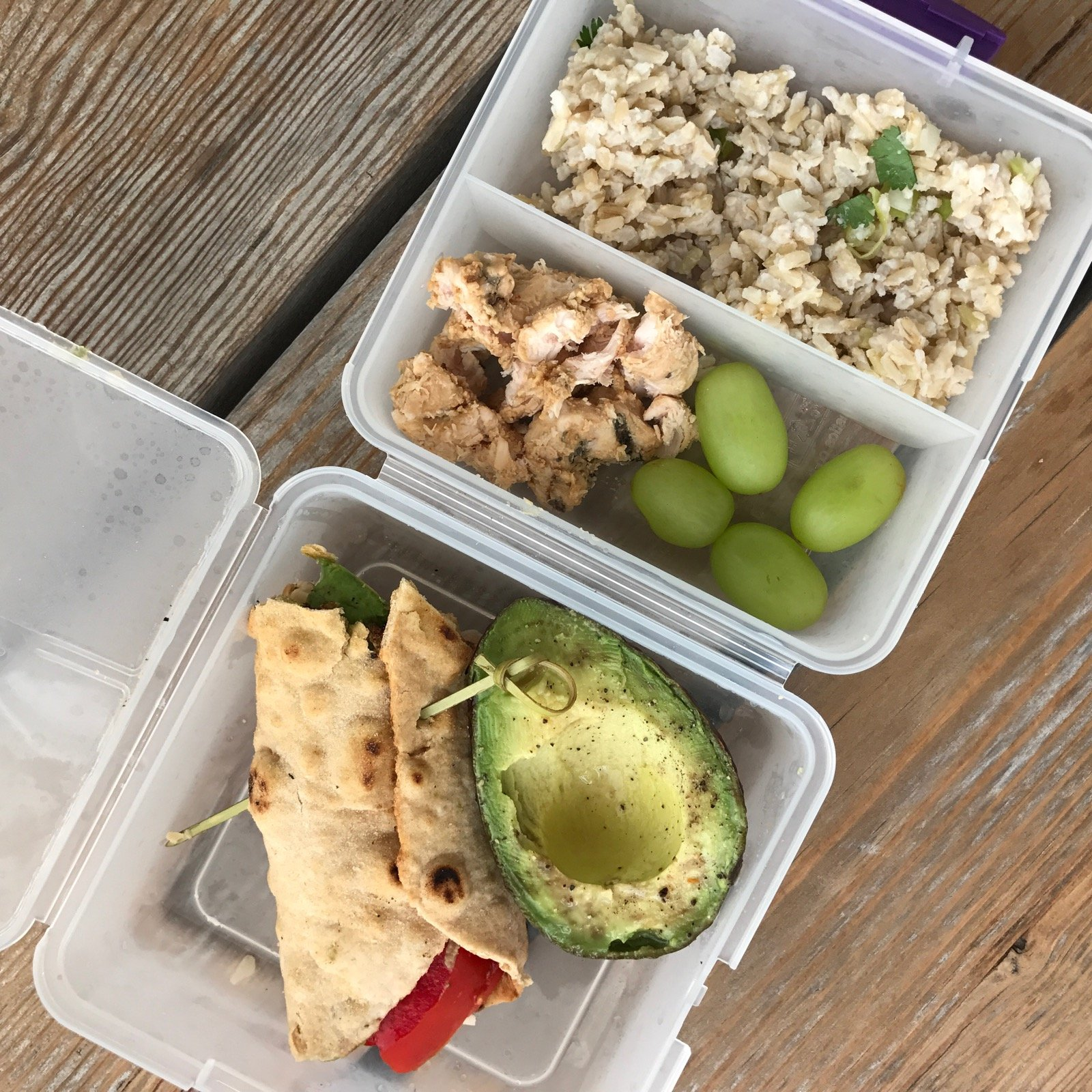 Packed school lunch of Hummus/cheese/tomato/lettuce wrap Avocado (she squirted a little lime juice on it) Grapes Leftover Chicken Satay and Coconut Rice (both served cold)