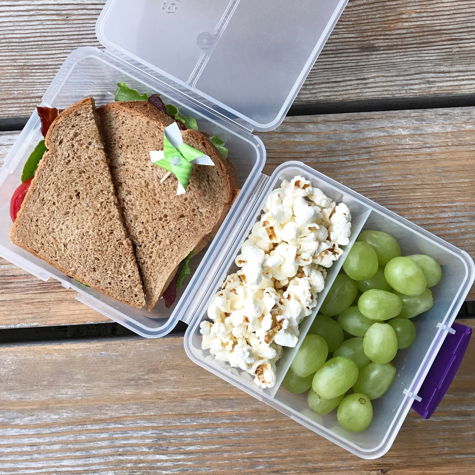 Packed school lunch with BLT on Whole-Wheat bread, Grapes, Popcorn