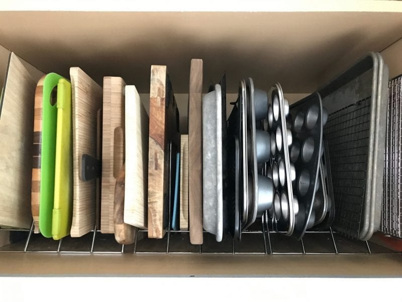 Cabinet storage rack for cutting boards and pans