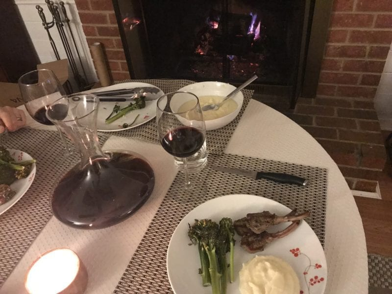 Grilled lamb chops, mashed potatoes, and broccolini paired with red Virginia wine