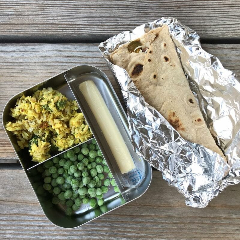 homemade veggie bean burritos, leftover chicken curry and broccoli casserole, frozen peas, and a cheese stick