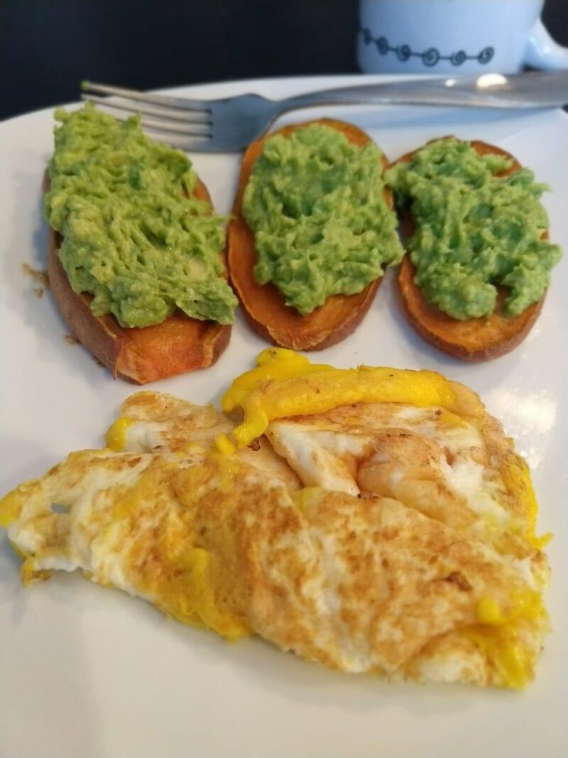 Avocado sweet potato toast with scrambled eggs