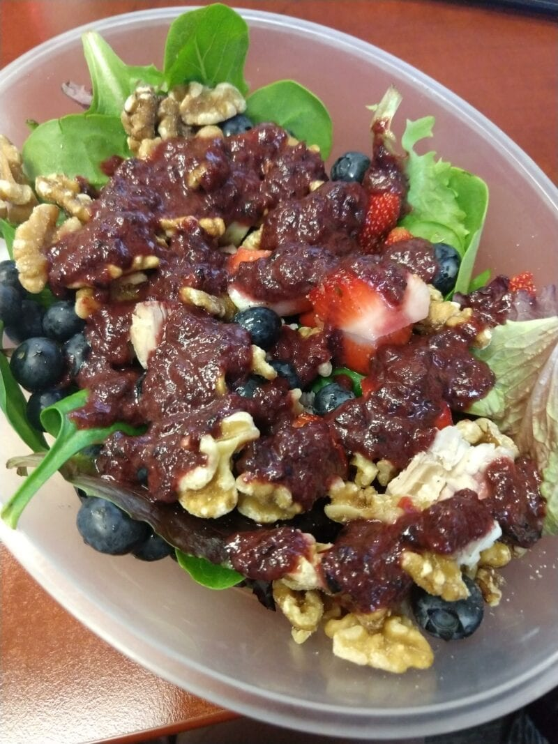 Salad with chicken, blueberries, strawberries, walnuts and homemade blueberry vinaigrette