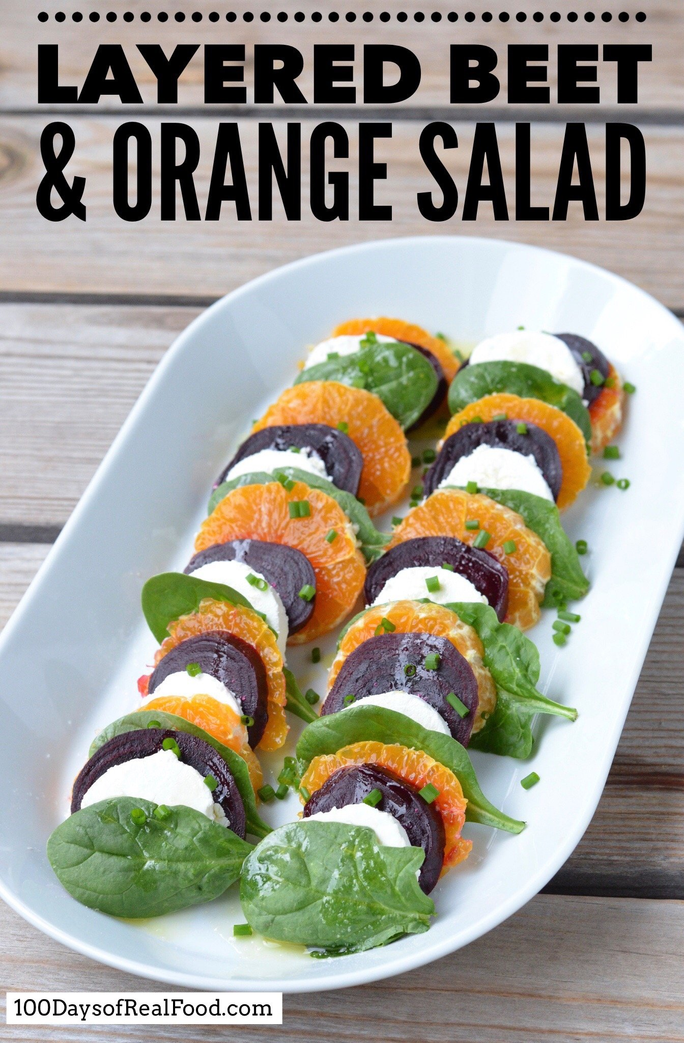 Layered beet, goat cheese, orange, and spinach salad on 100 Days of Real Food.