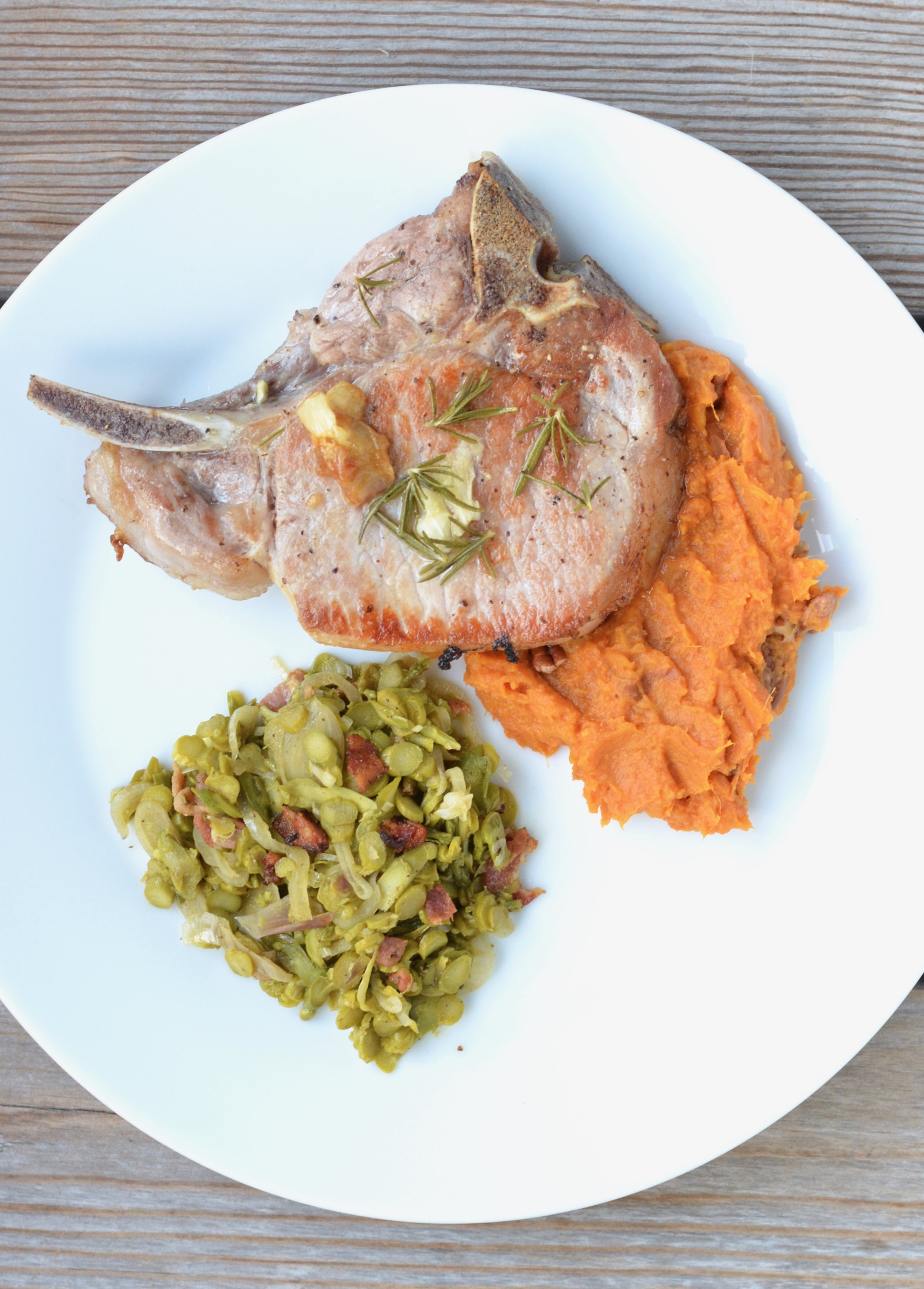 Rosemary & Roasted Garlic Pork Chop Recipe, asparagus, and mashed sweet potatoes