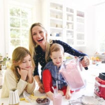 Catherine Mccord and family making smoothies