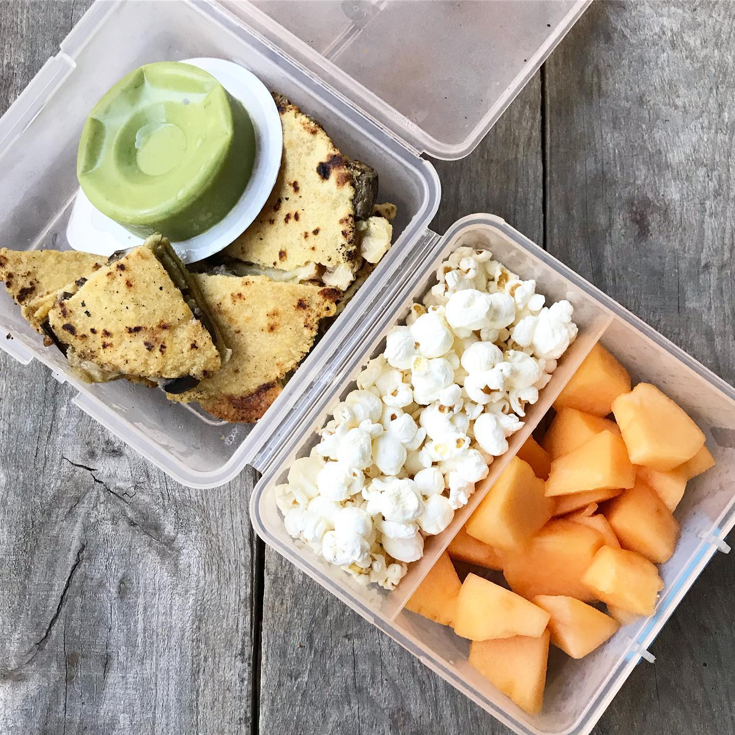 school lunch with quesadilla and popcorn from 100 days of real food