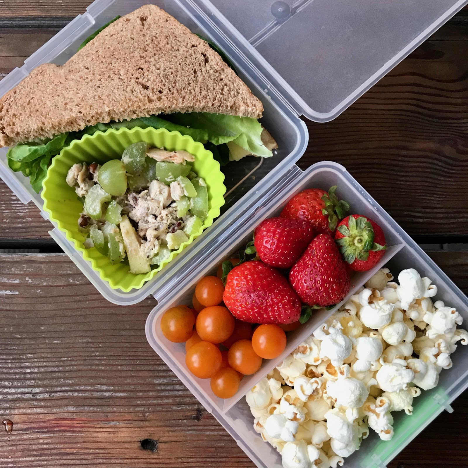 Hummus/cheese/lettuce sandwich, Loaded Chicken Salad, strawberries, cherry tomatoes, and popcorn