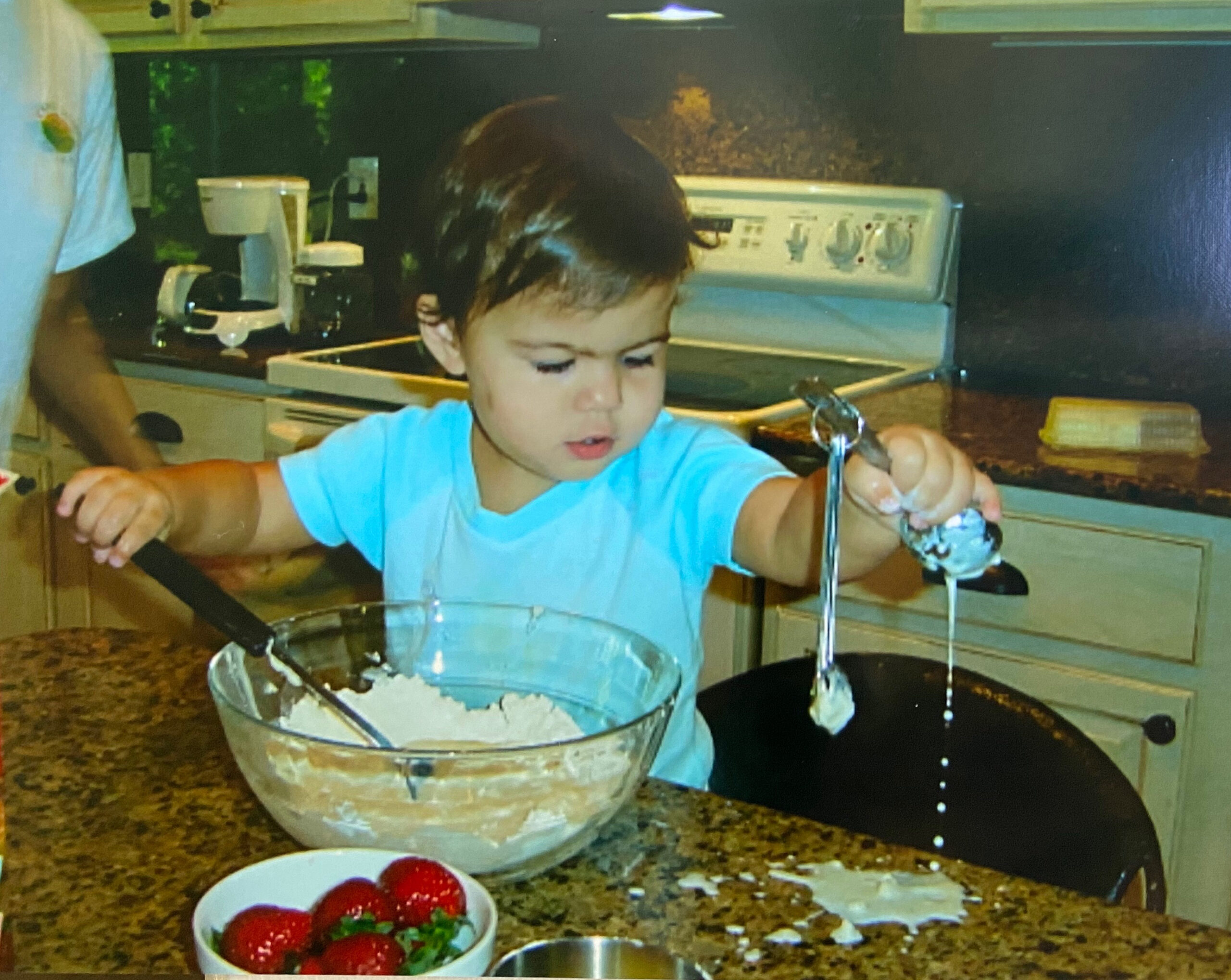 My daughter helping int he kitchen when she was a year and a half on 100 Days of Real Food