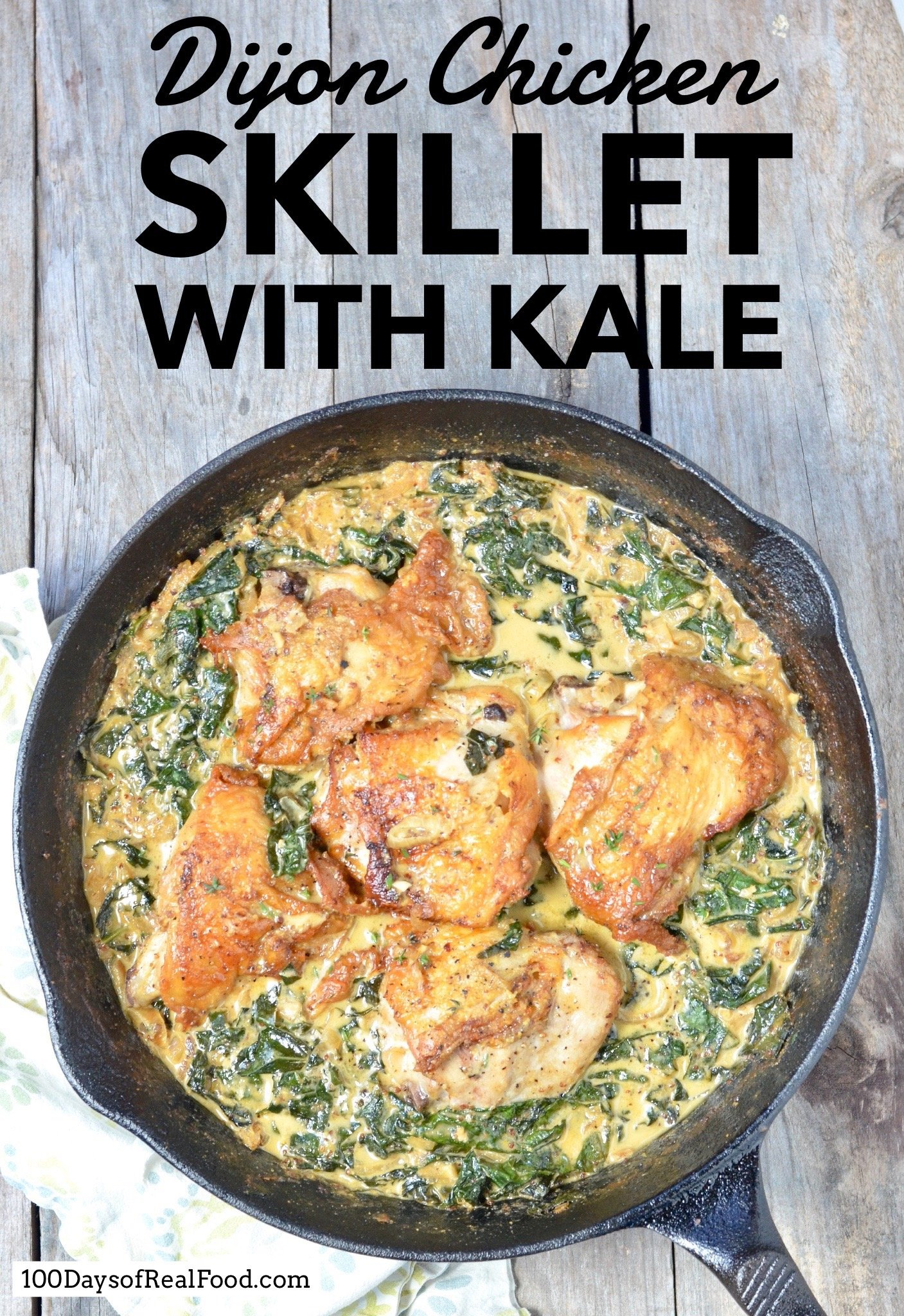 Dijon Chicken Skillet with Kale in cast iron skillet on table