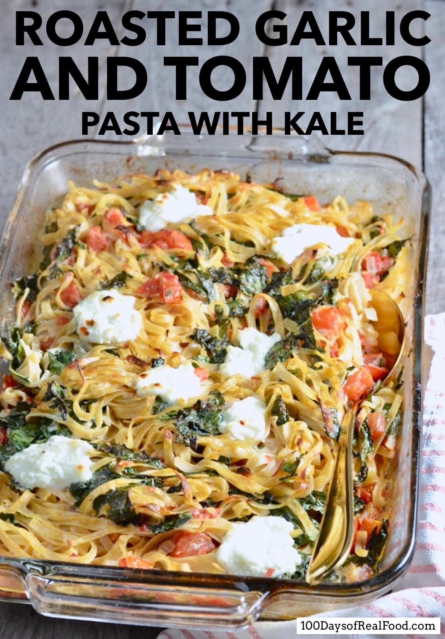 Roasted Garlic and Tomato Pasta with Kale in rectangular baking dish
