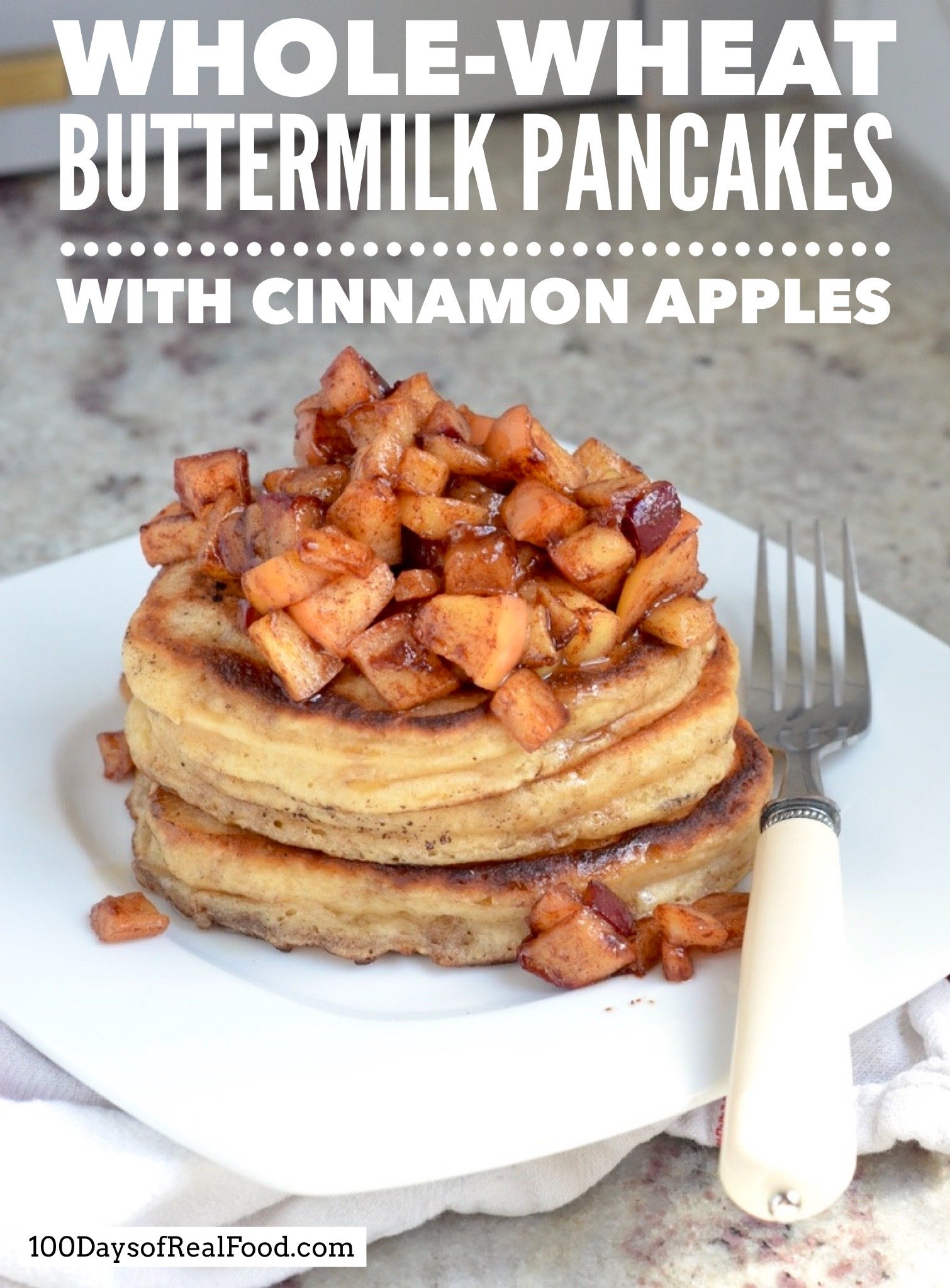 Buttermilk Pancakes  topped with cinnamon apples on a plate with fork