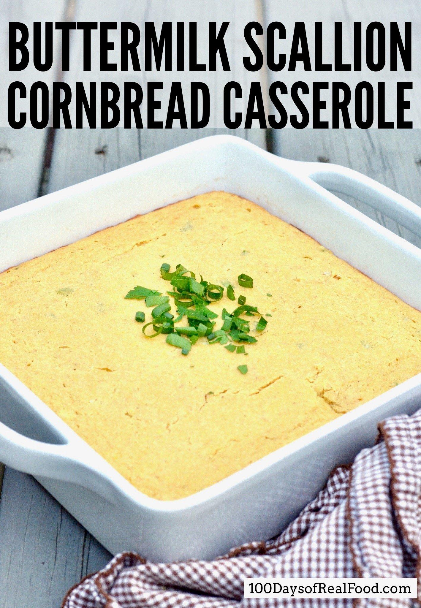 Buttermilk Scallion Cornbread Casserole in a white baking dish on a table