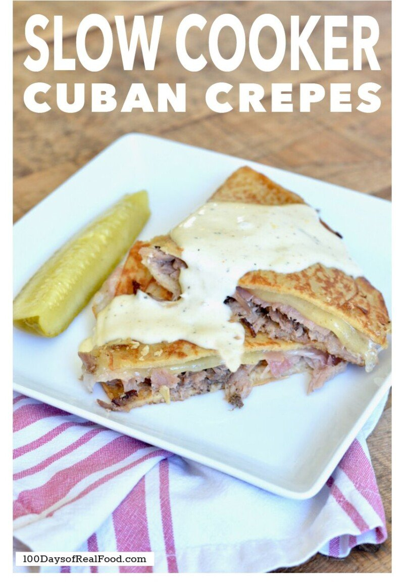 Cuban Crepes on a white plate with a pickle on the side