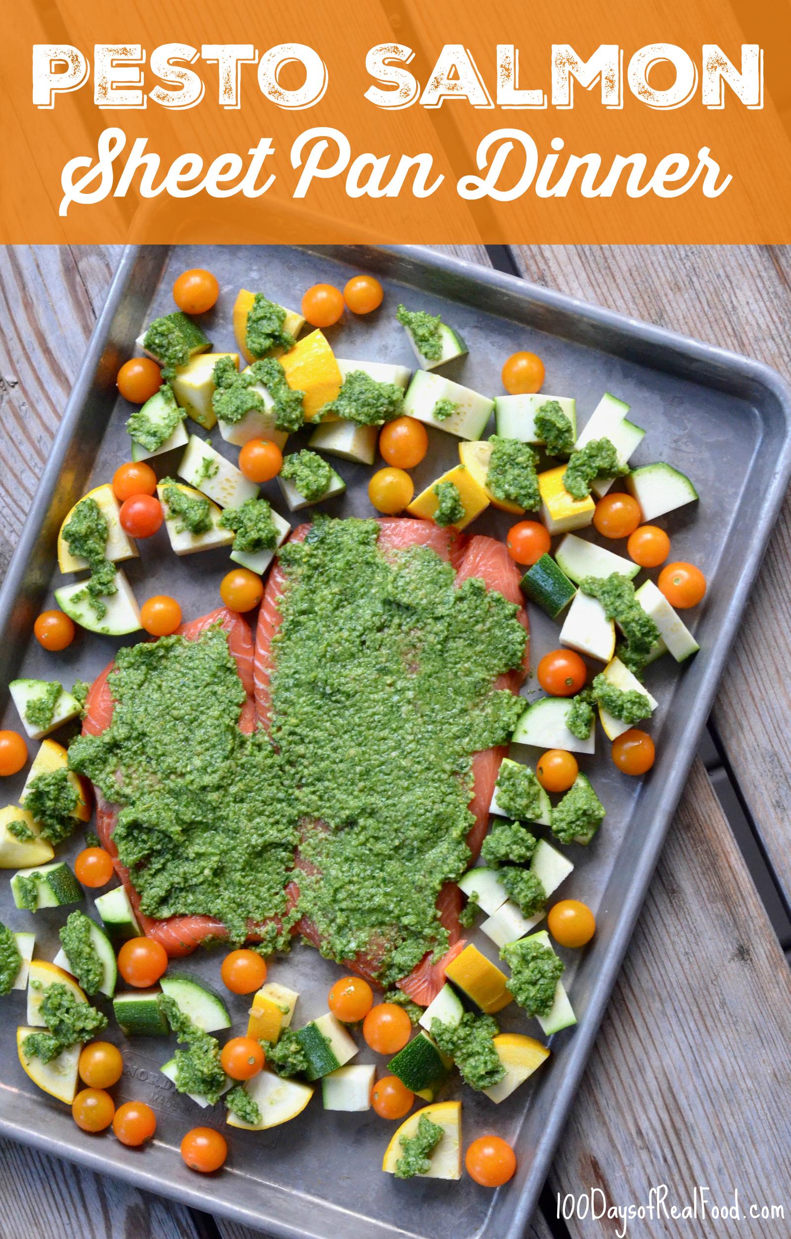Pesto Salmon and vegetables on baking sheet
