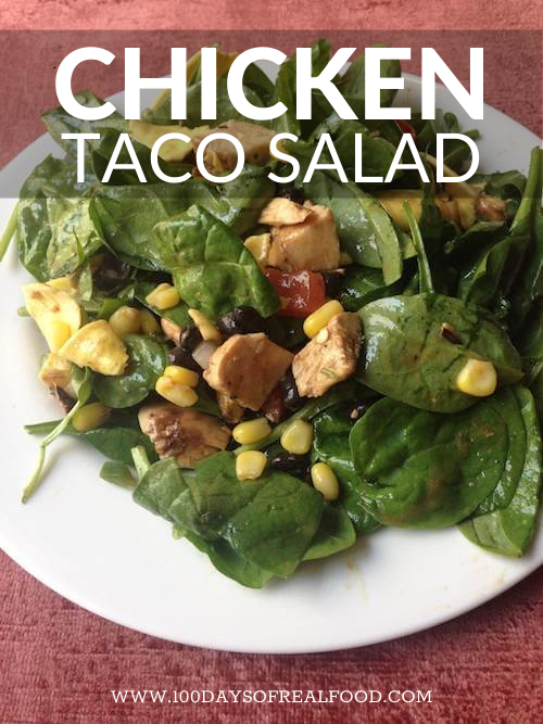 A Chicken Taco Salad topped with corn and beans.