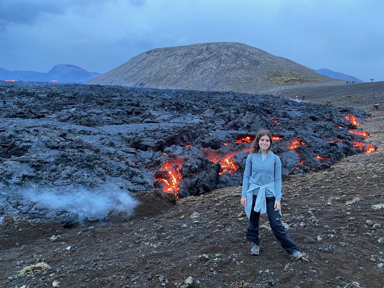 Teen girl posing in front of Fagradalsfjall Volcano.