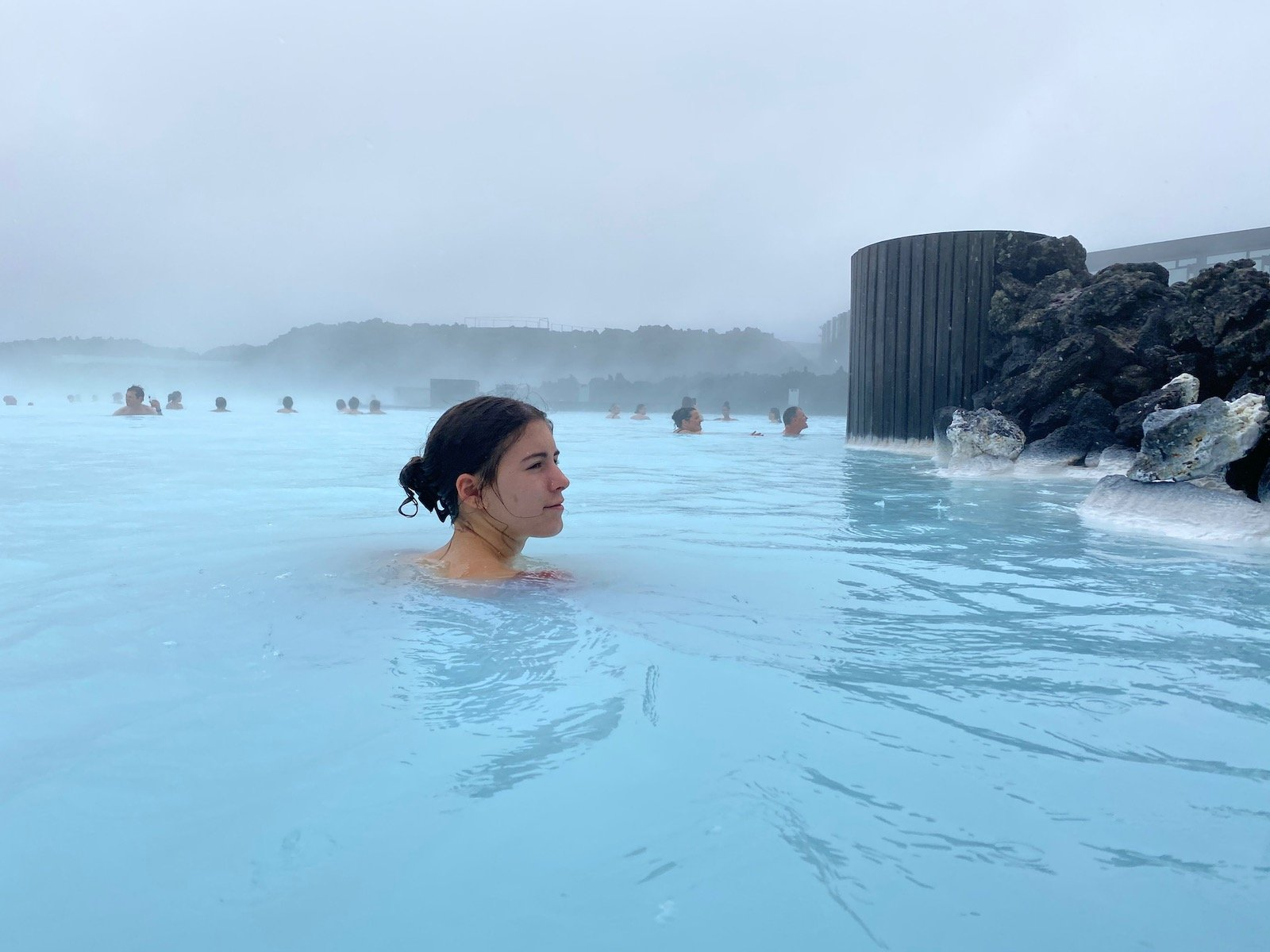Teen girl swimming in the Blue Lagoon in Iceland.