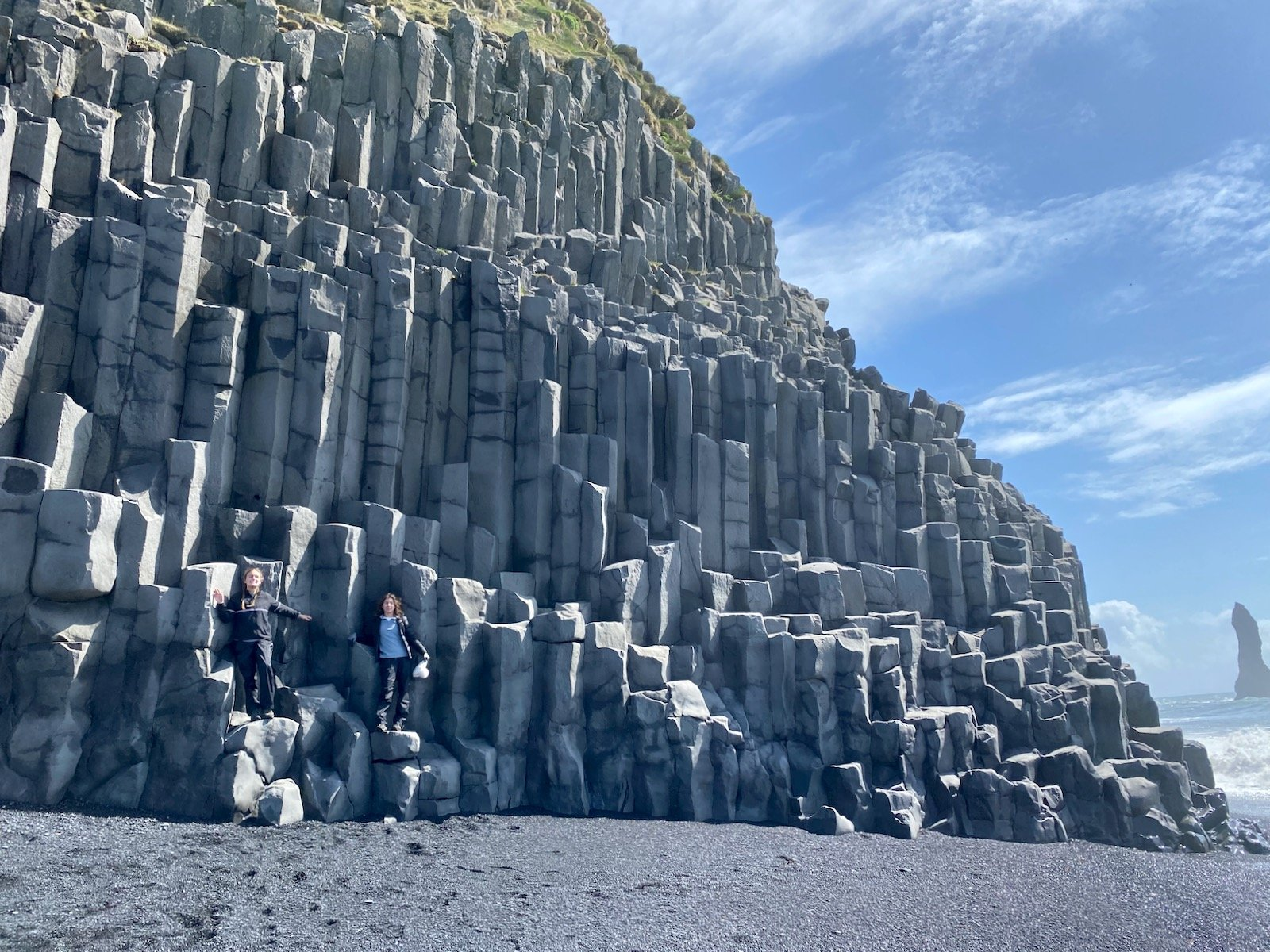Sisters posing on the Basalt Columns in Iceland.