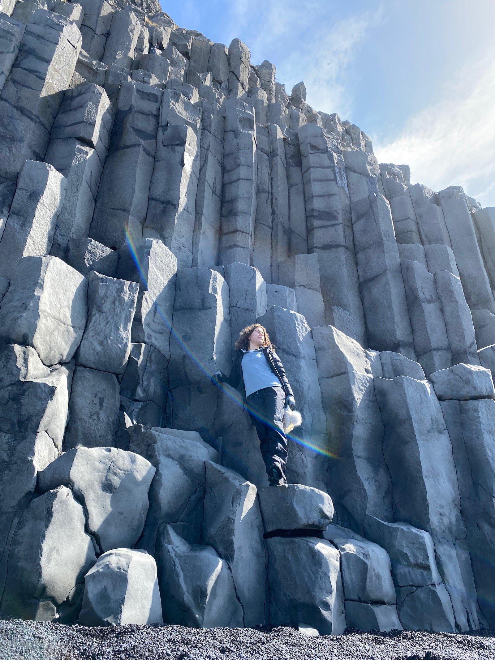 Teen girl posing on the Basalt Columns in Iceland.