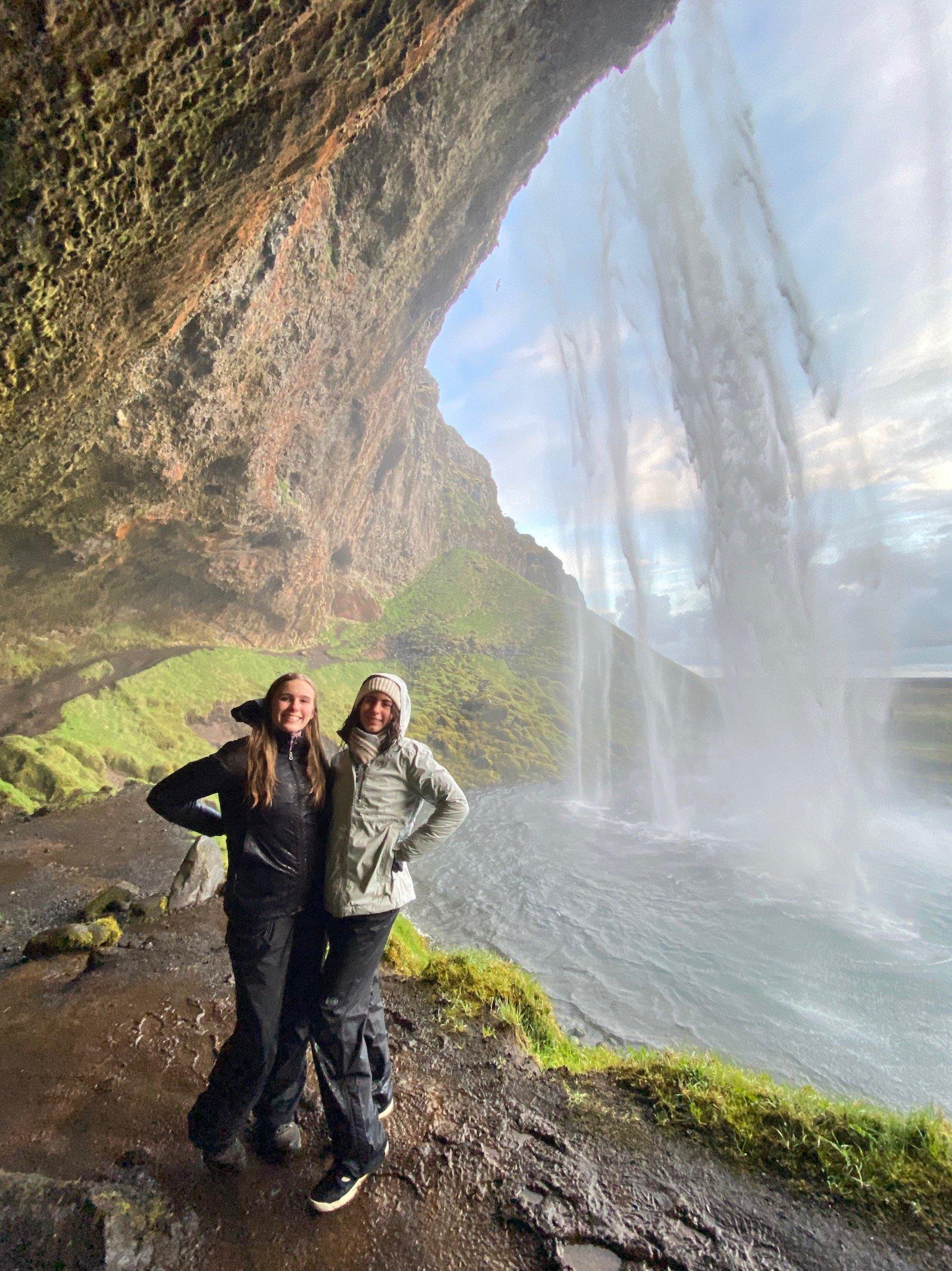 Sisters posing at Seljalandsfoss Falls near Vik in Iceland.
