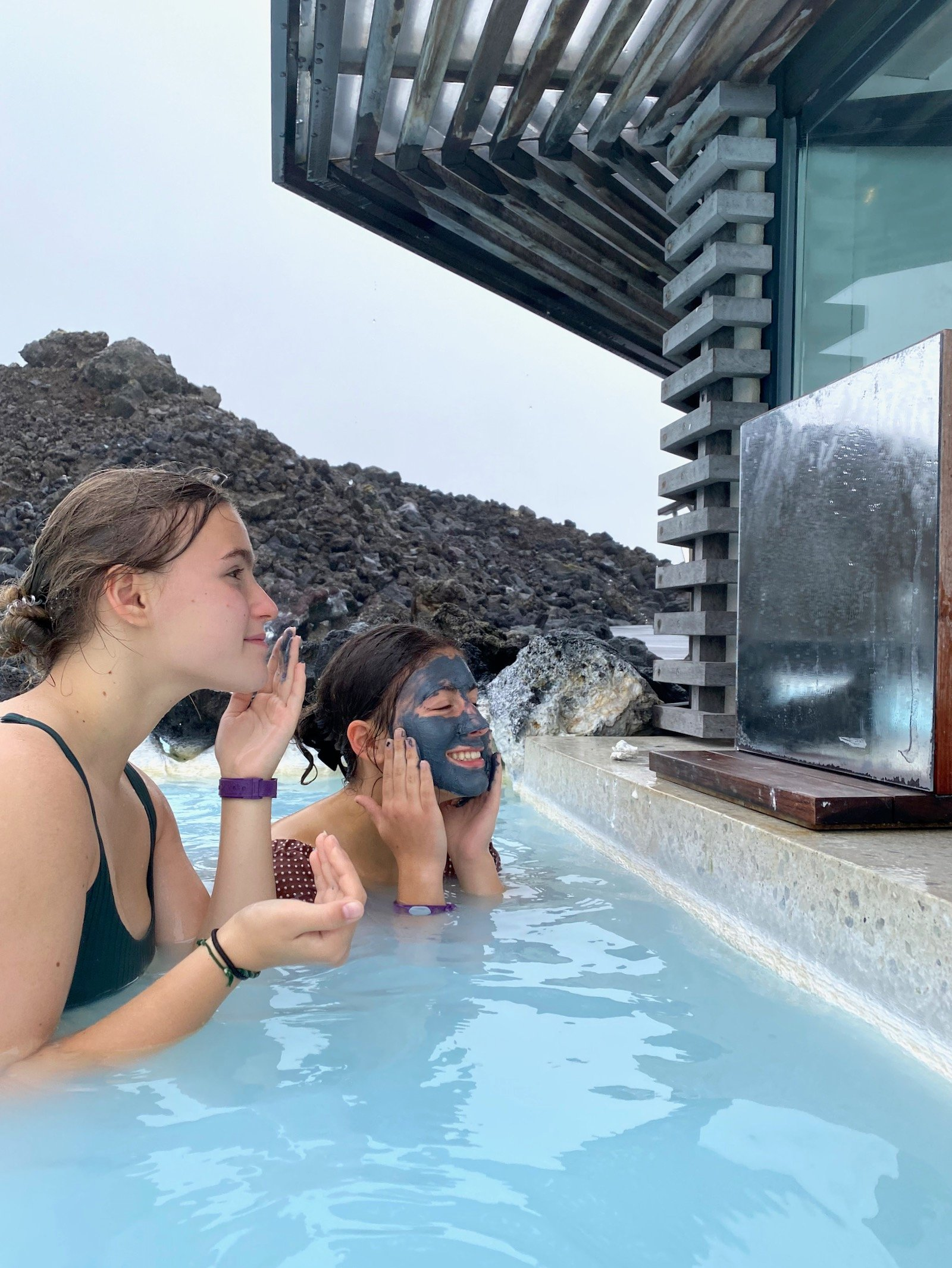 Sisters applying mud mask in the Blue Lagoon in Iceland.