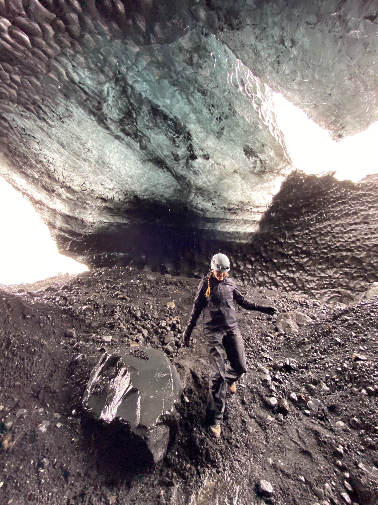 Teen girl exploring the ice caves in Iceland.