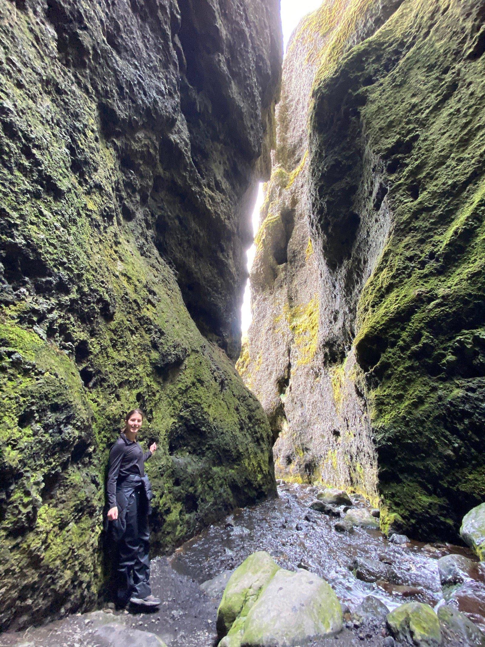 Teen girl posing in front of canyon on Snæfellsnes Peninsula.