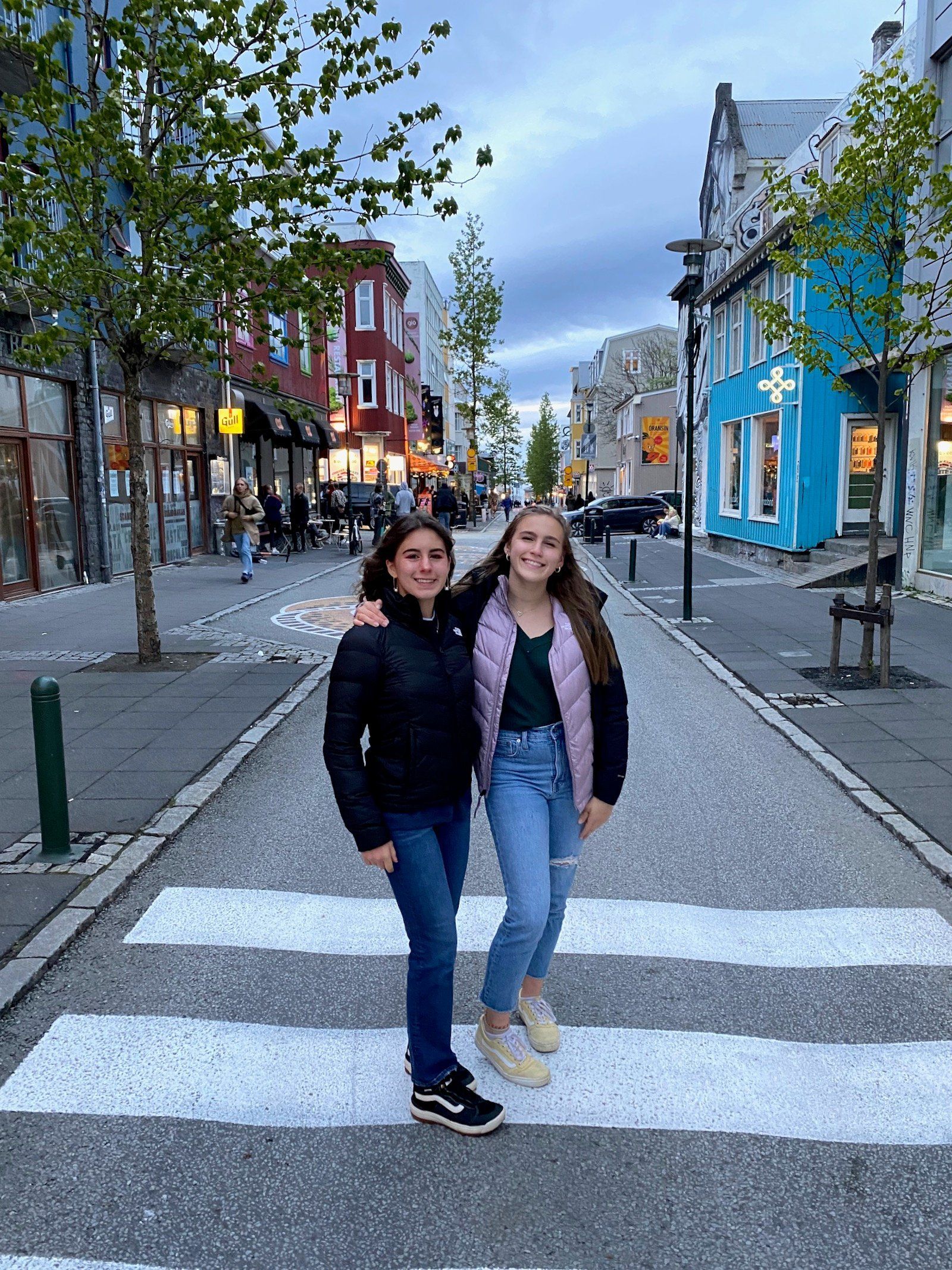 Sisters posing in the streets of Reykjavík.