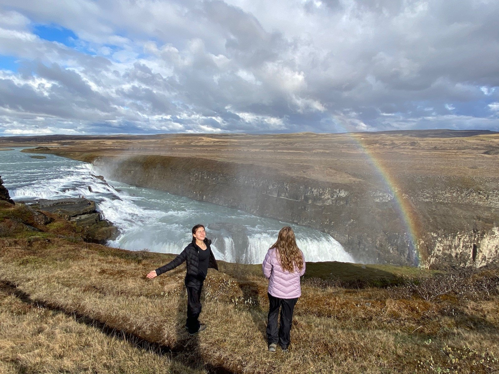 Sisters enjoying the scenic view at Gullfoss Falls on the Golden Circle in Iceland.